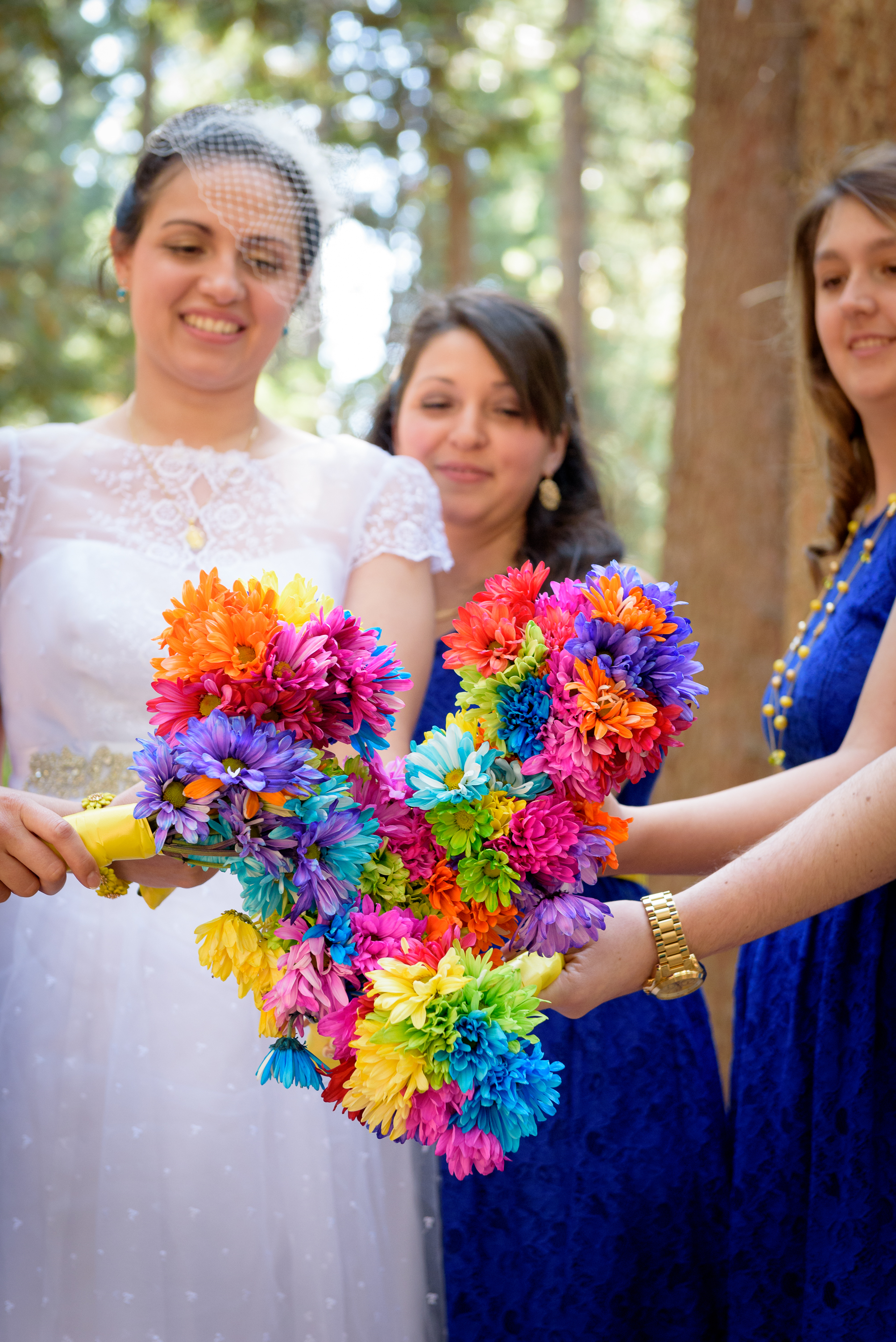 Erika and her bridesmaids make a heart out of bouquets
