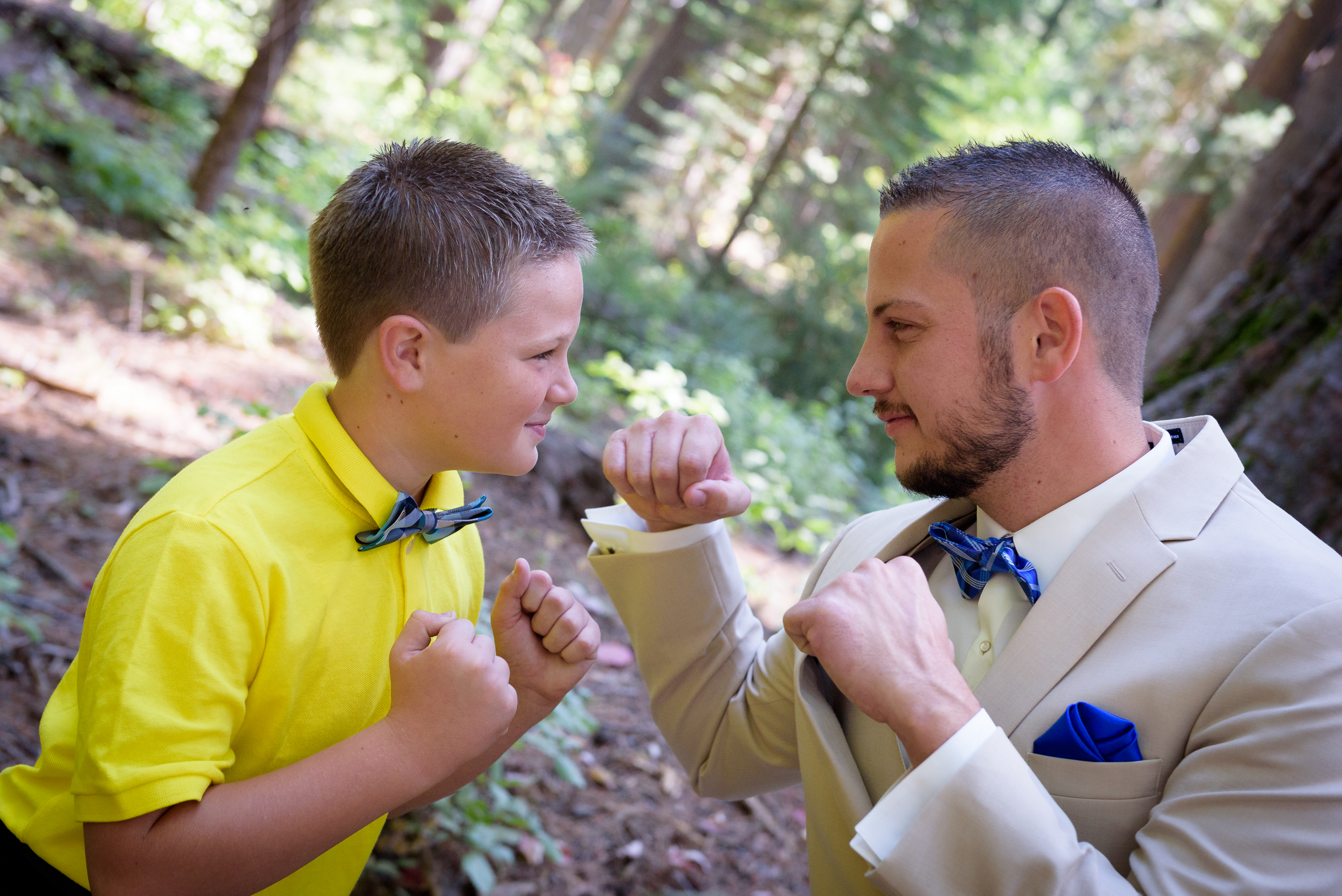 Luke and his ring bearer pretend to fight.