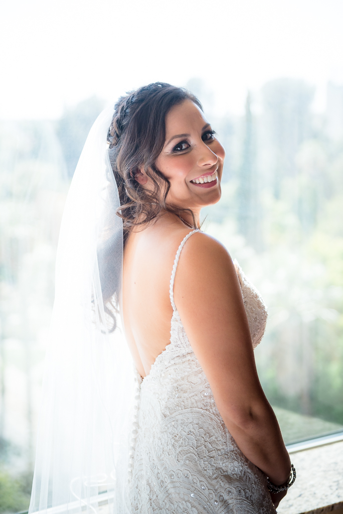 Photograph of a Latina bride dressed in her wedding gown.