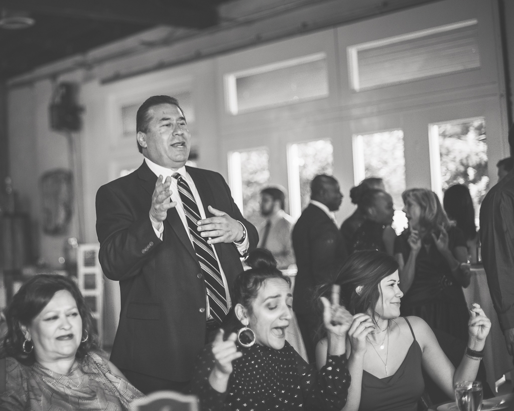 Guests at a wedding reception break out in song!