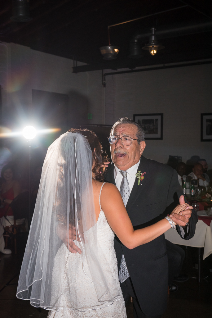 A grandfather sings a traditional spanish song while dancing with the bride.