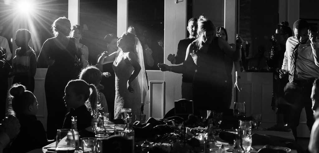 Black and white photos of guests dancing at a wedding reception.