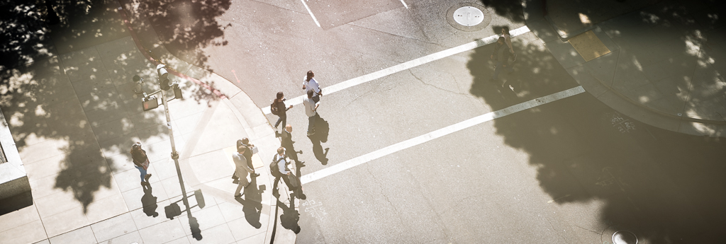 Overhead photograph of a groom crossing the street with his groomsmen.