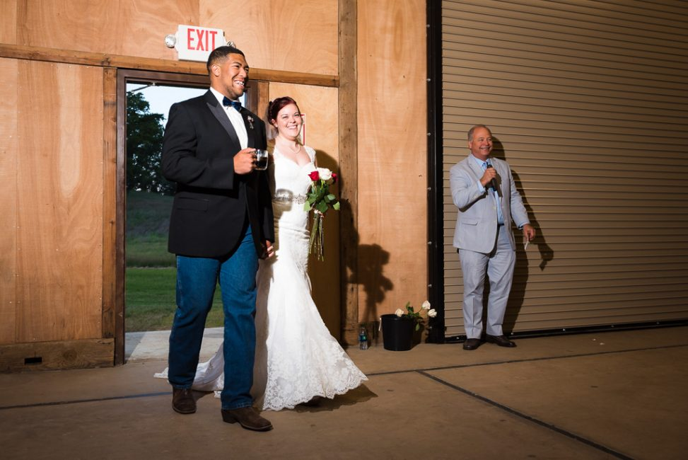 A bride and groom are announced as they enter the Bayley Barn.