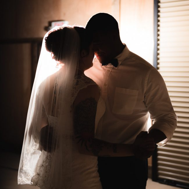 A groom and bride have their first dance as a married couple at the Bayley Barn.