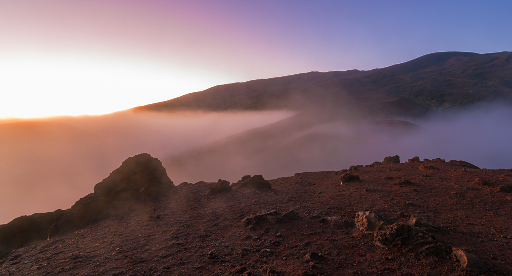 Landscape photograph of a sunset captured high up the slopes of Mauna Kea.
