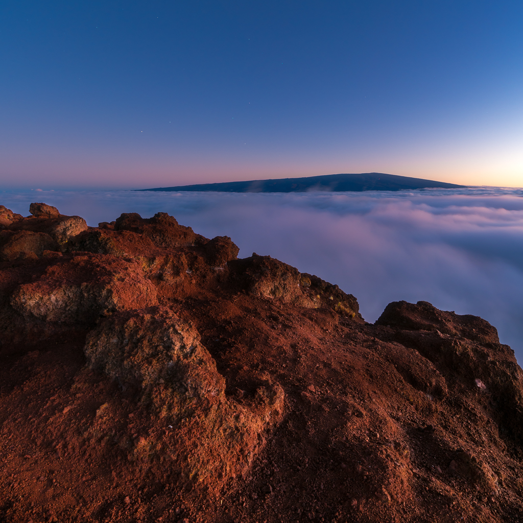 Landscape sunset photograph taken from the top of a Mauna Kea cinder cone toward Mauna Loa.