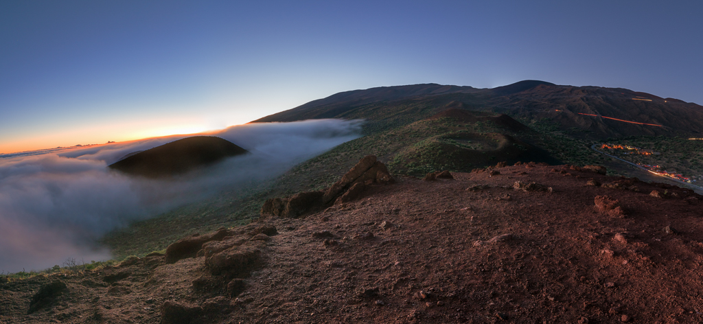A panoramic landscape photograph of sunset near the top of Maunakea.