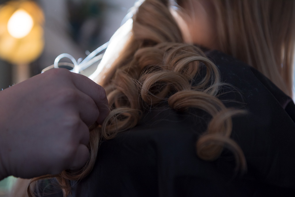 Close up photograph of tight curls in a bride's hair.