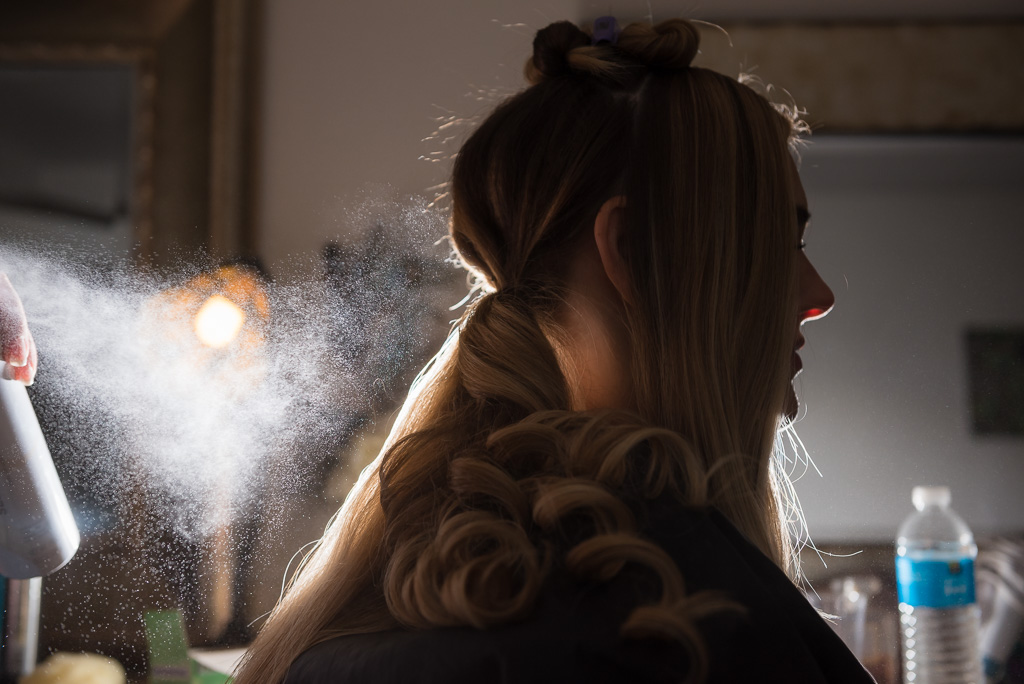 A photograph of a bride under an illuminated cloud of hairspray.