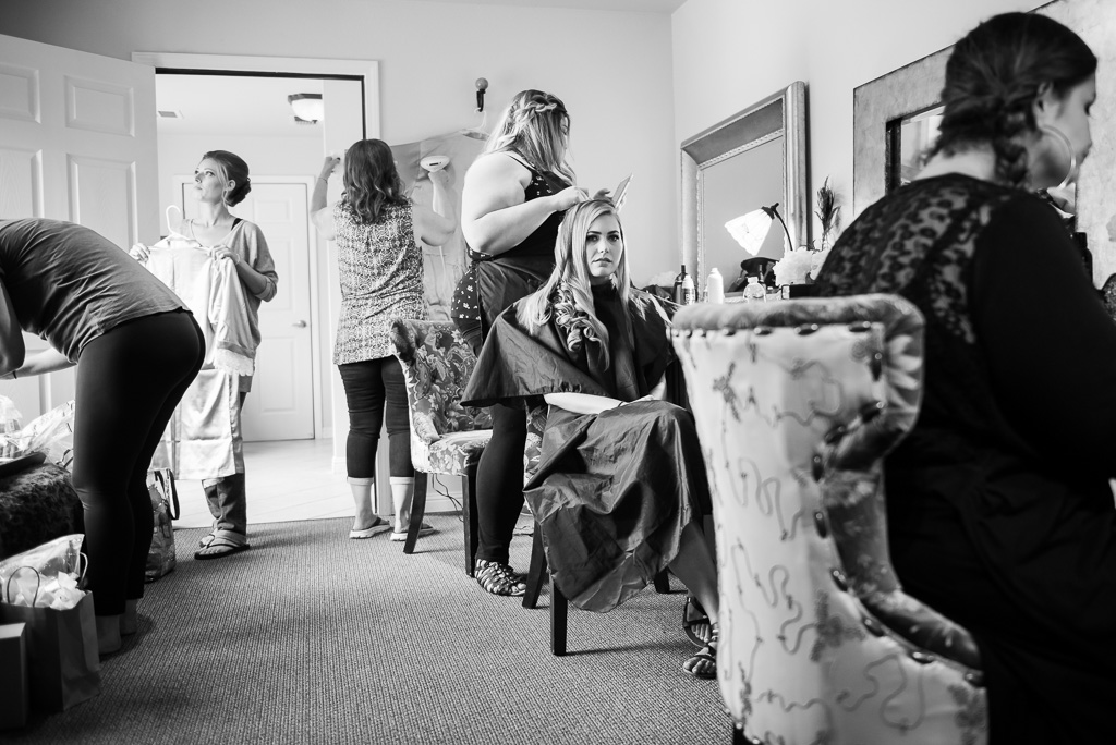Black and white photographof a bride having her hair done.
