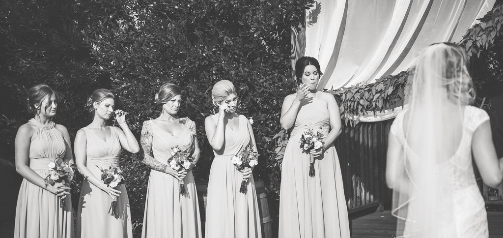 Black and white photograph of bridemaids crying.