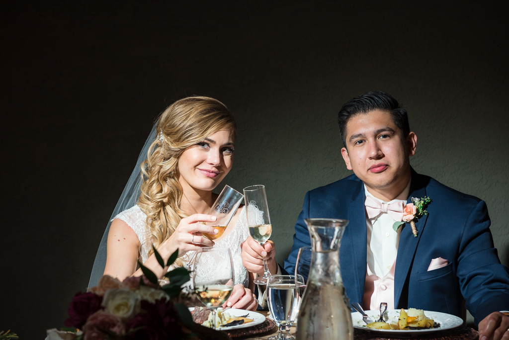 Photograph of bride and groom joining the toast.
