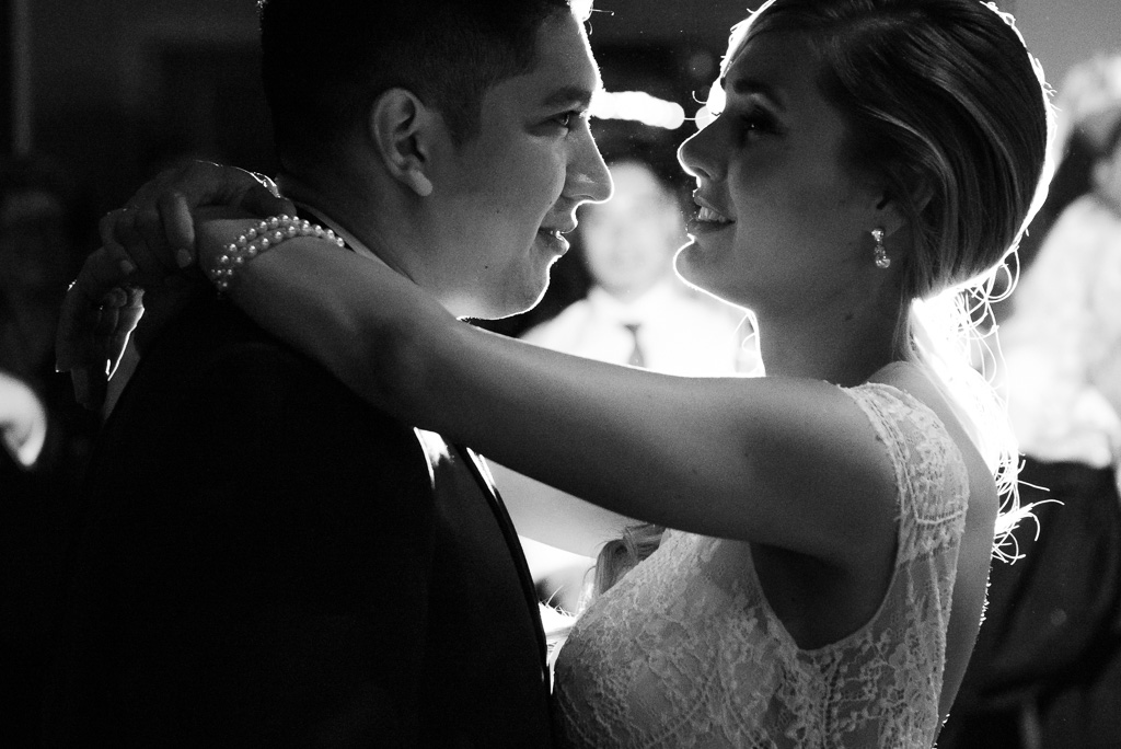 Black and white photo of a bride and groom's first dance.