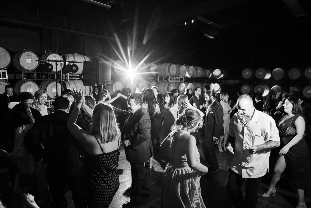 Black and white photo of wedding guests out on the dance floor.