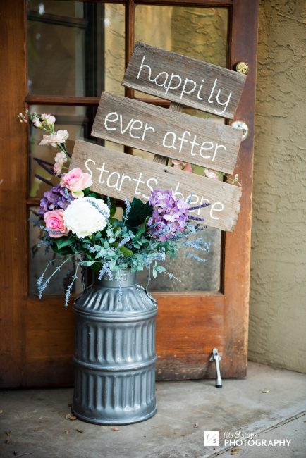 A floral display at the front door of a wedding venue.