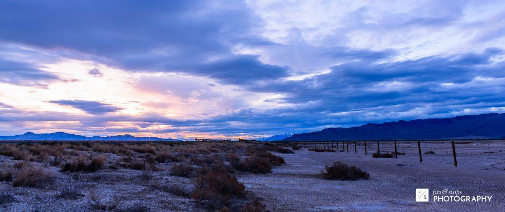 Landscape photo of the Utah Salt Flats at sunrise.