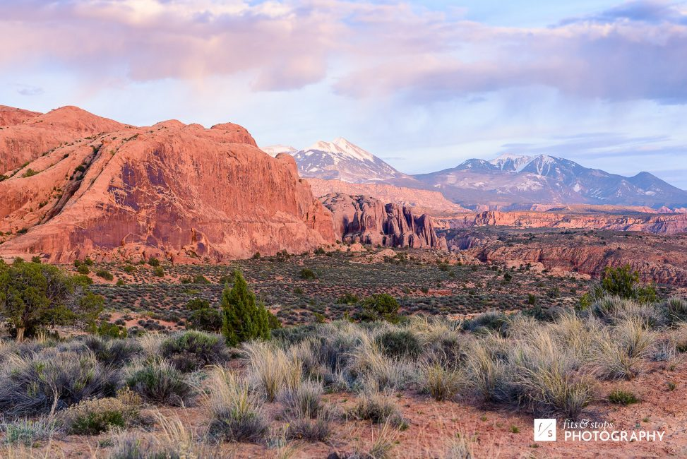 Landscape photograph of a sunset over the desert and La Sal Mountains near Moab, Utah.