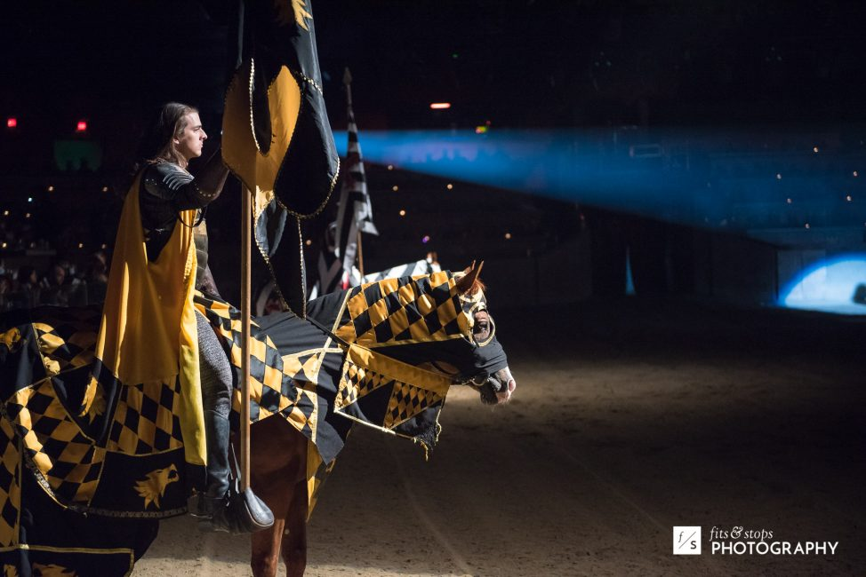A knight in yellow clothing awaits his chance to compete at Medieval Times Dinner Theater.