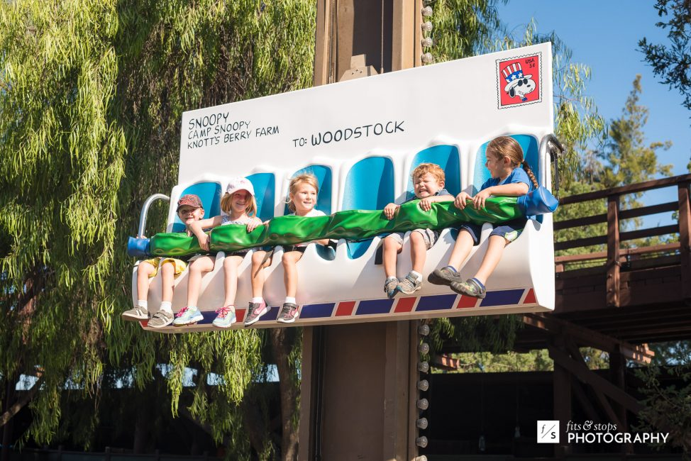 A group of kids rides a postal envelope ride at Knott's Berry Farm. One of them is freaking out.