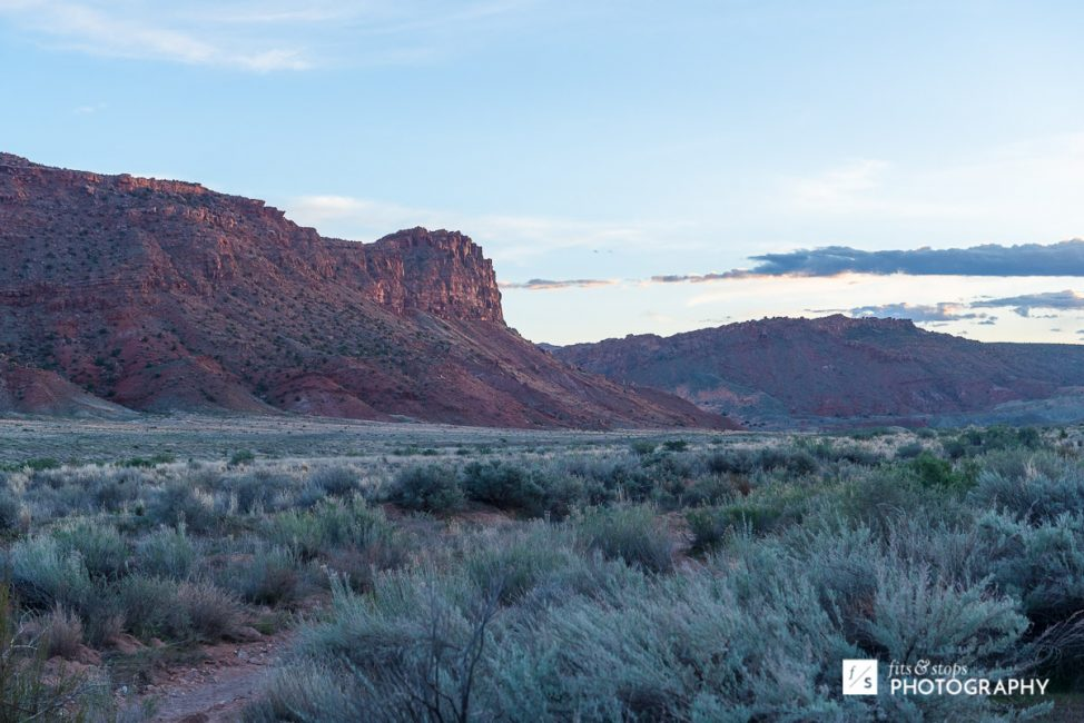 Landscape photo of the valley beneath the Delicate Arch in Arches National Park.