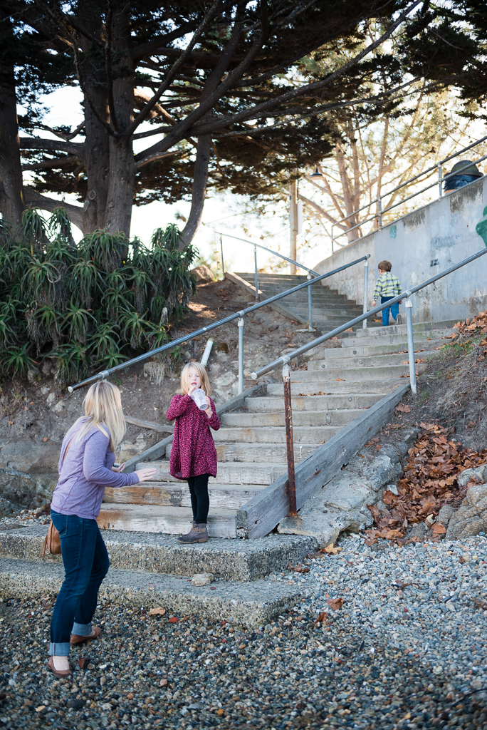 A young boy leads his sister and mom up a stair case at Fisherman's Shoreline Park.