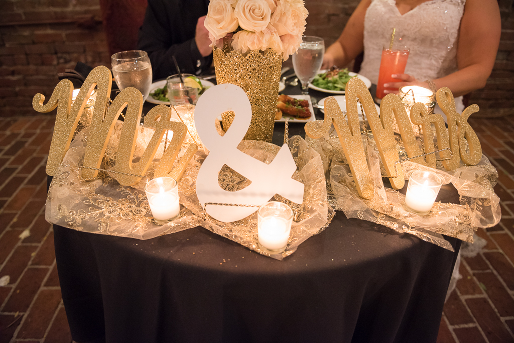 Photograph of a head table at a wedding ceremony.