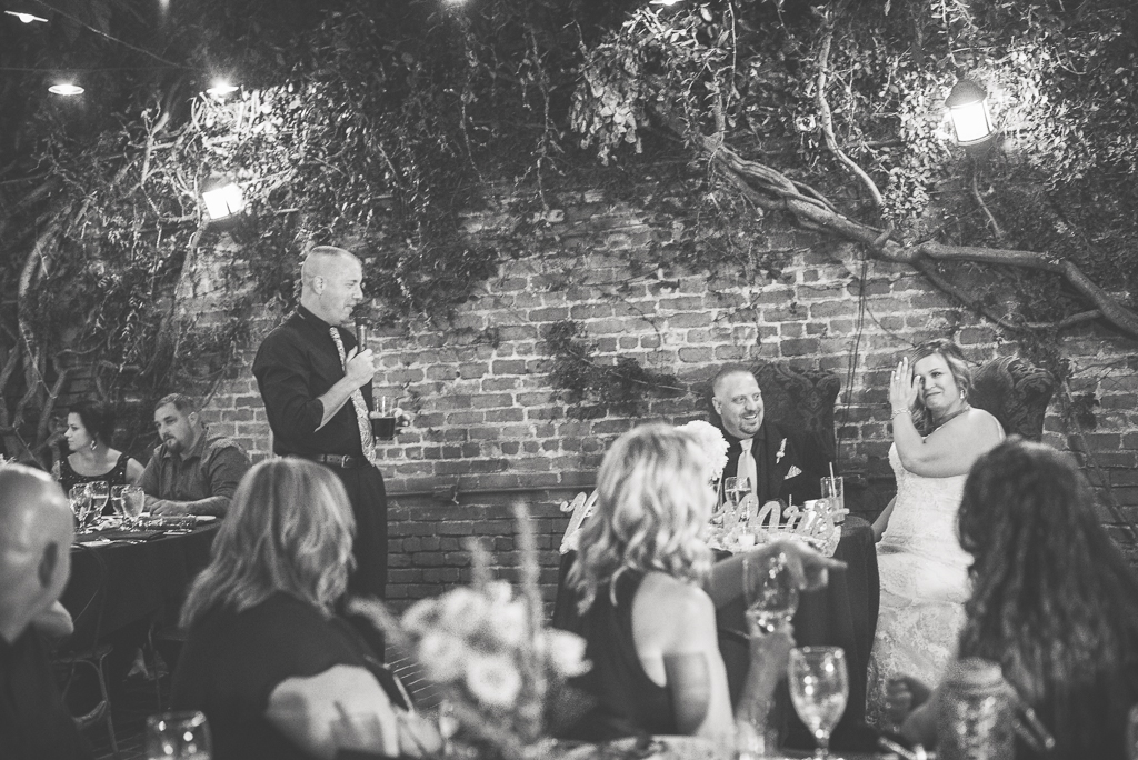 The groom's brother delivers a toast speech at the Firehouse Restaurant.