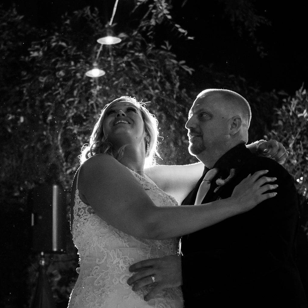 Black and white photograph of a newly married couple's first dance.