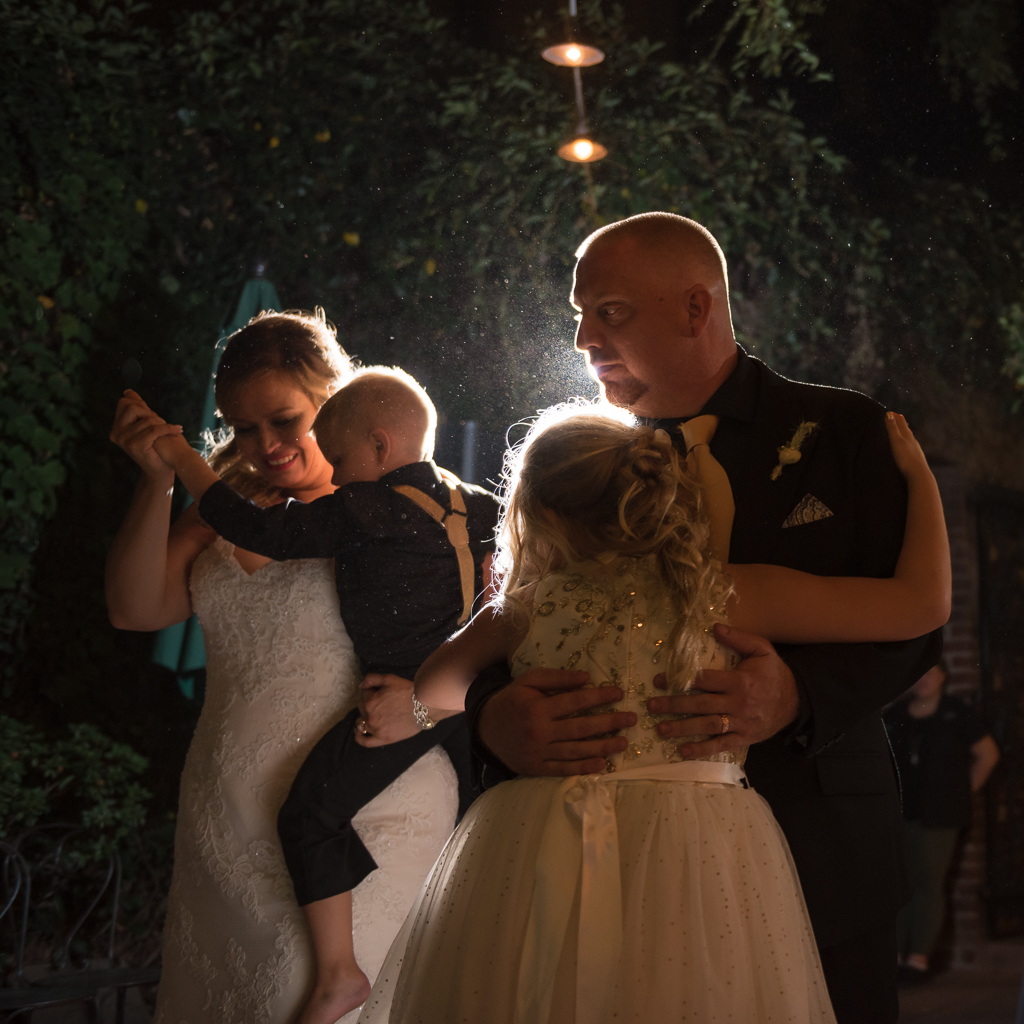 A bride's son and daughter jump in on the first dance.