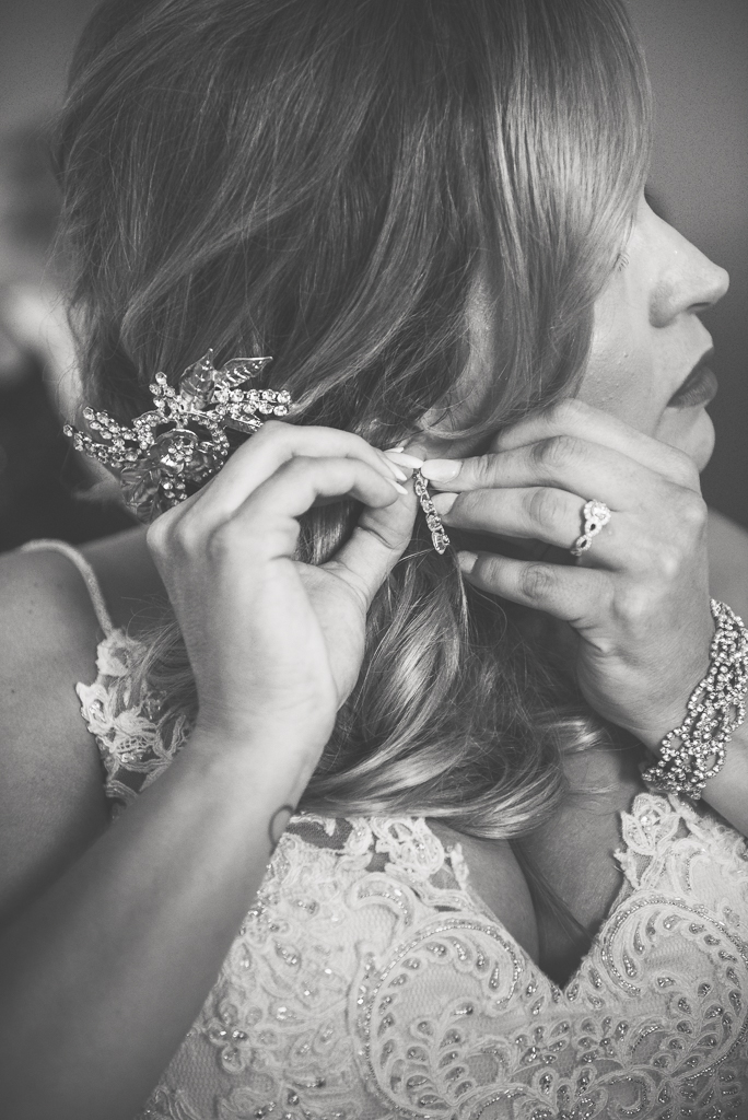 A black and white photograph of a bride preparing for her wedding day.