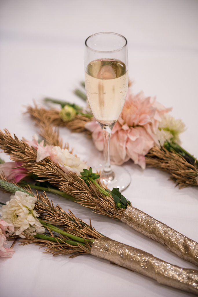 Detail photograph of bouquets and a glass of champagne.