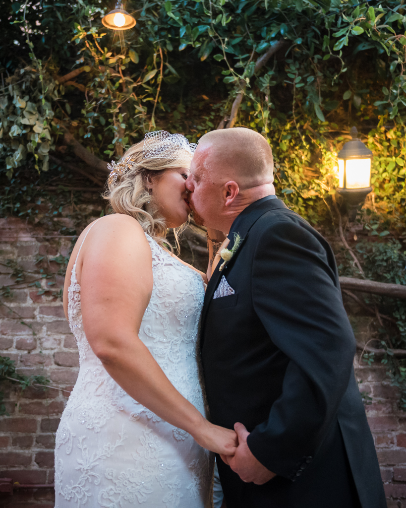 A bride and groom kiss at the Firehouse Restaurant in Old Sacramento.