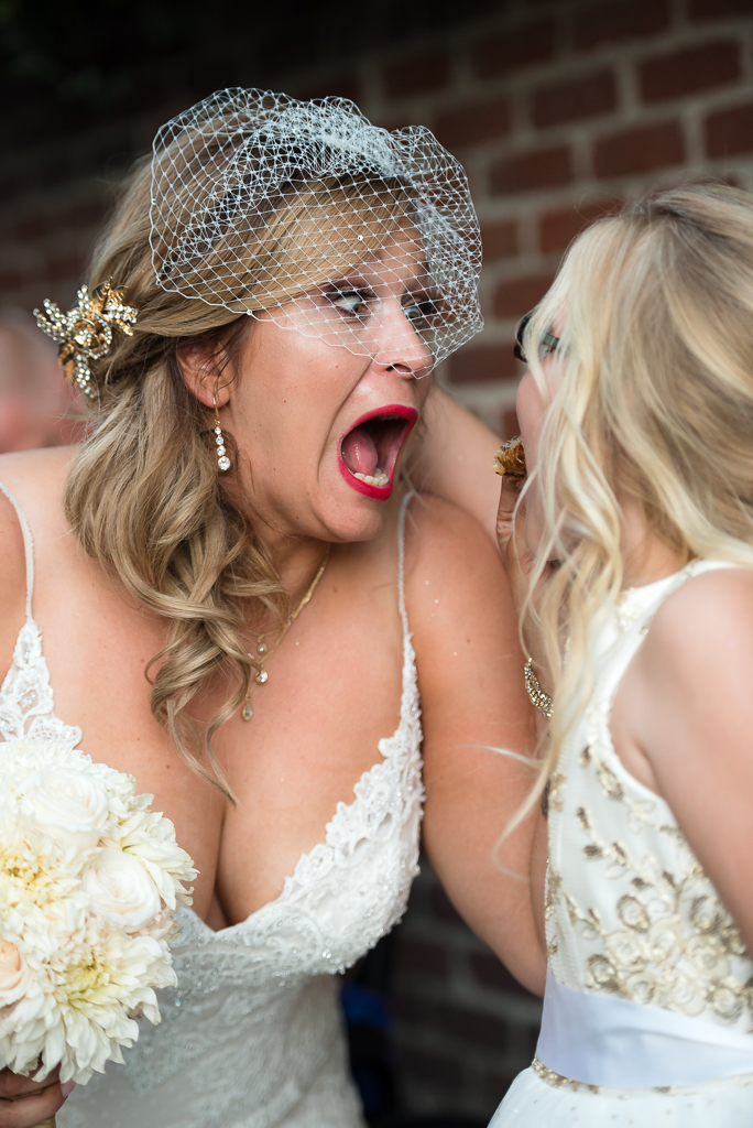 A bride jokes around with her daughter after her wedding ceremony.