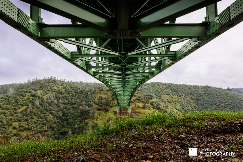 A landscape photograph of the underside of Northern California's Foresthill Bridge