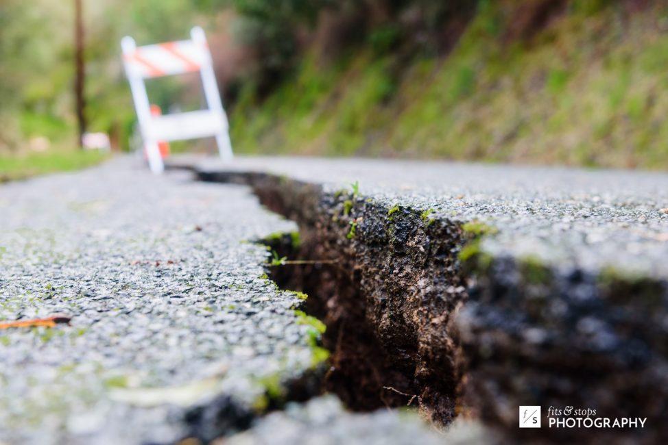 A crack forming in an asphalt road.