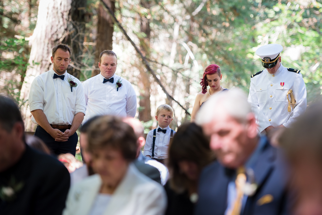Guests and some of the bridal party praying during a wedding communion ceremony.