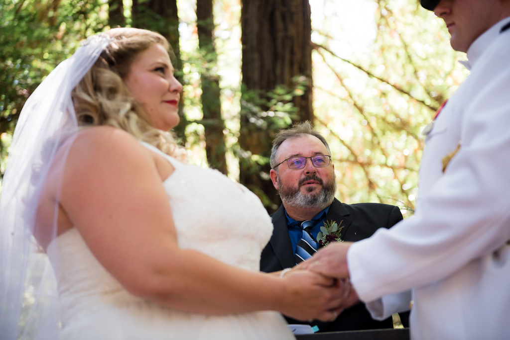An officiant looks on as his niece marries her groom.