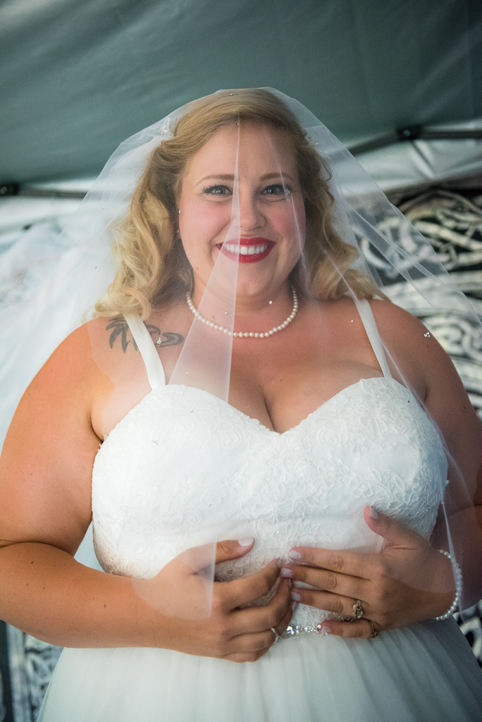 A bride is preparing to walk down the aisle on her wedding day.