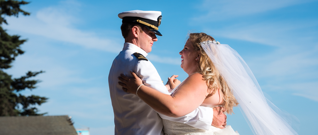 A photograph of a bride and groom sharing their first dance, outdoors at a beach in Aptos, CA.