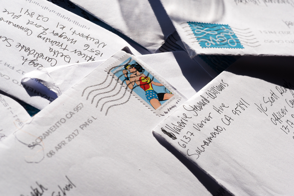 Envelopes with a silver age Wonder Woman stamp.
