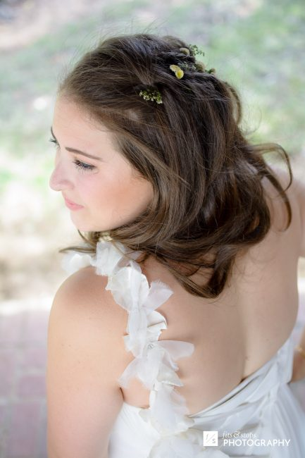 Photograph of a young bride from behind.