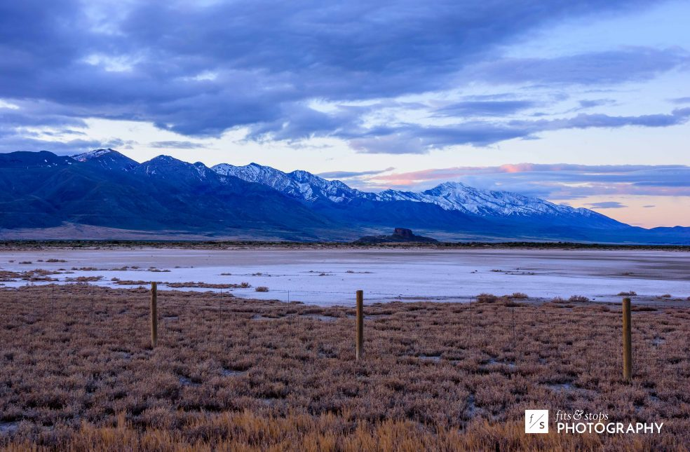 Landscape photograph of a mountain range stretching down to the Utah Salt Flats.